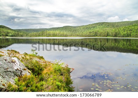 Reflection on a lake in Norway. - stock photo