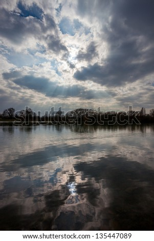 reflection on lake with dark clouds