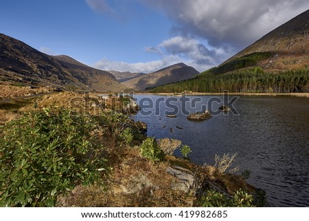 Reflection on the lake in Black Valley,Kerry,Ireland - stock photo