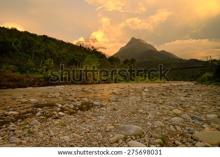 Reflection Sunset at Tambatuon, Kota Belud, Borneo, Sabah, Malaysia Image has grain or blurry or noise and soft focus when view at full resolution.  (Shallow DOF, slight motion blur) - stock photo