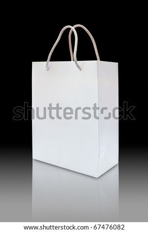 reflection white paper bag on black background - stock photo