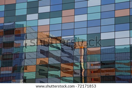 Reflection with colors in office window - stock photo
