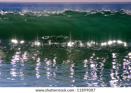Reflections in a Crashing Wave look like Jewels - stock photo