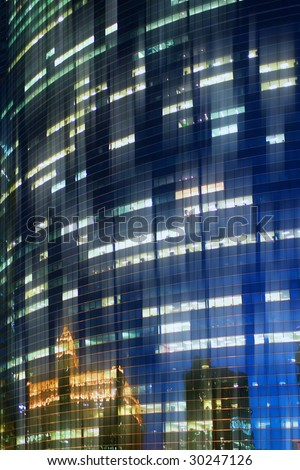 reflections in glass wall - stock photo