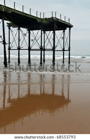 Reflections in the sea as the tide comes in. Early morning in June. - stock photo