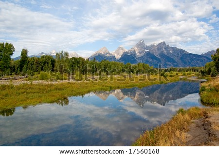 Reflections in water of the Grand Tetons park - stock photo