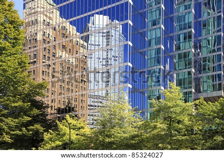 Reflections in windows of modern office buildings (Downtown. Vancouver. Canada)