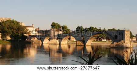 Reflections of a bridge in Avignon, France - stock photo