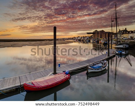 Reflections of a stunning sunrise over the harbour at Wells-next-the-Sea.
