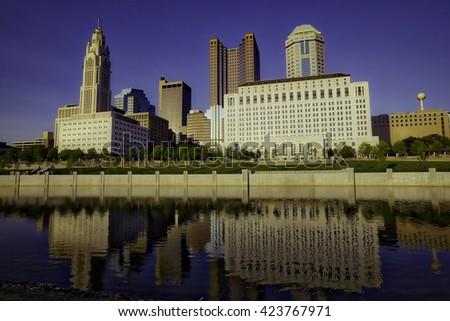 Reflections of Columbus, Ohio in the Scioto River - stock photo