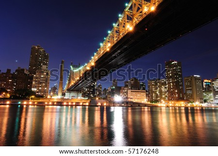 Reflections of Midtown Manhattan and the landmark Queensboro Bridge in New York City.