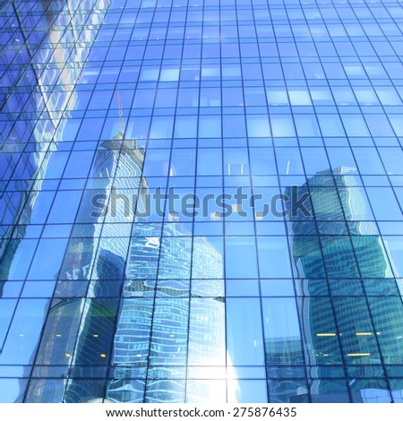 Reflections of modern office buildings - architectural and business background - stock photo