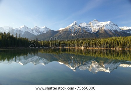 Reflections of mountain and forest in lake, - stock photo