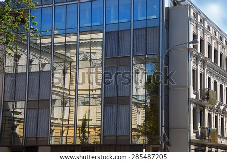 reflections of old building in windows on Sienkiewicza street in Lodz,Poland - stock photo