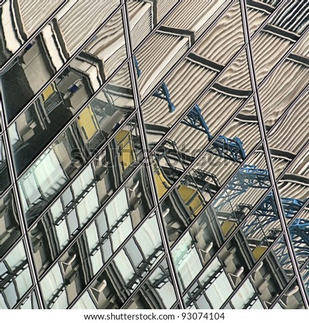 Reflections of one building in another - stock photo