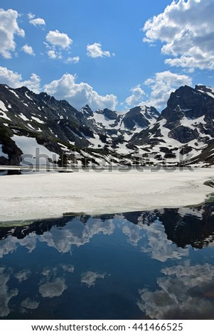 reflections of peaks in lake isabelle, indian peaks wilderness area, colorado - stock photo