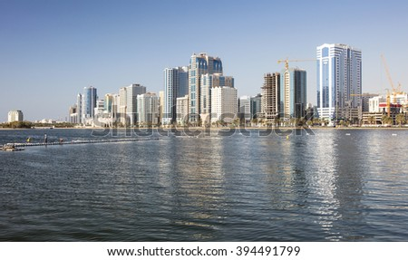 reflections of skyscrapers in water in city in united emirates