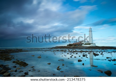 Reflections of St Mary's Lighthouse near Whitley Bay , Northumberland , England