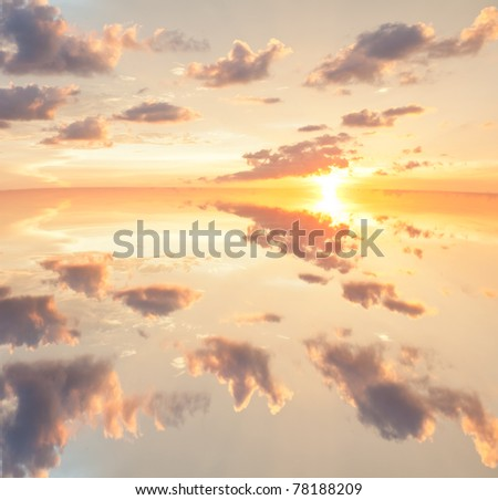 Reflections of sunset in surface lake water - stock photo