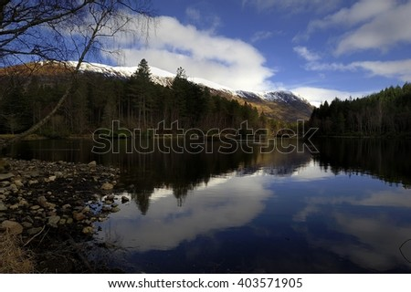 Reflections of the trees in the Loch - stock photo