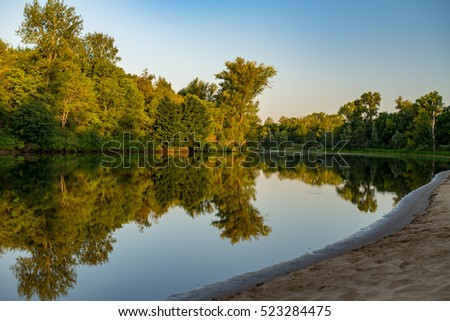 Reflections of tree in the river, Volga, Russia