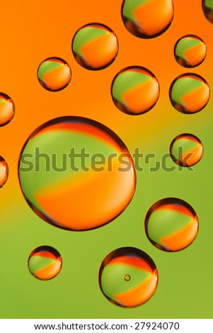 Reflections of two color background in a Flying drops - stock photo