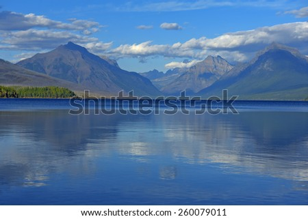 Reflections off Lake McDonald in Glacier National Park, Montana.  - stock photo