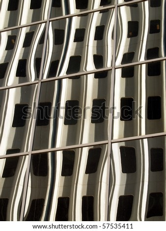 Reflections on a highrise in panes of glass on another building