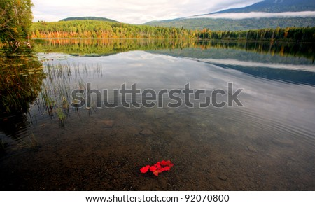 Reflections on a mountain lake in British Columbia - stock photo