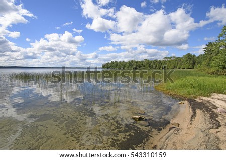 Reflections on a Sandy Shore in the Wilds of Basswood Lake in Quetico Provincial Park in Ontario