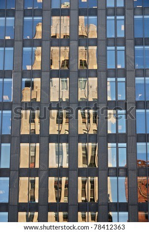 Reflections on Glass Office Tower Old Montreal, Canada - stock photo