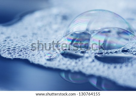 Reflections on soap bubbles, very close shot - stock photo