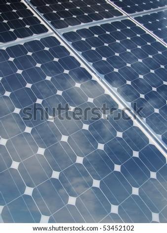 reflections on solar panel - stock photo