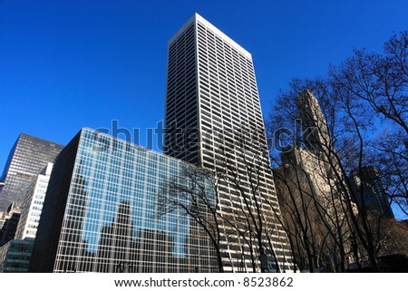 Reflective corporate building on a clear day in manhattan - stock photo