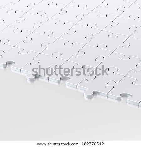 Reflective metal surface half-covered with the chrome puzzle pieces as a copyspace background composition - stock photo
