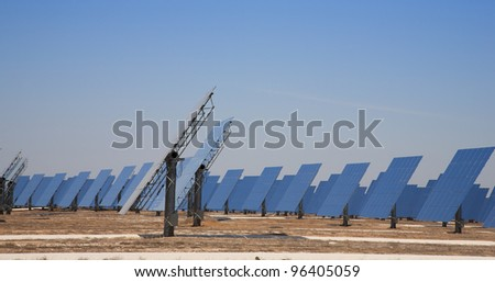 Reflective panels of a solar thermal plant in circular arrangement - stock photo