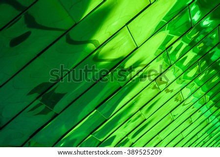Reflective shiny green abstract background.