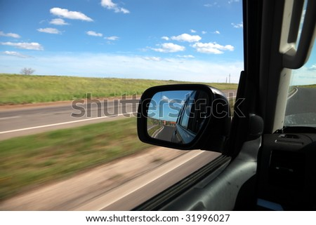 Reflexion in a mirror of high-speed movement of cars