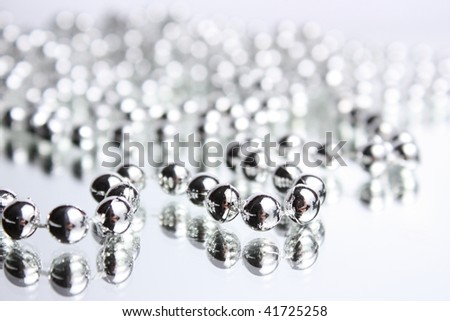 Reflexion of a silver beads in mirror
