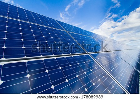 Reflexion of the sky on the photovoltaic modules - stock photo