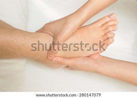 Reflexology foot massage - stock photo