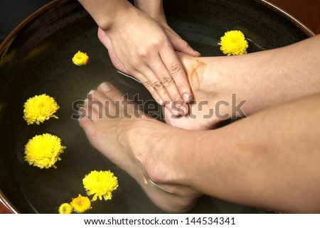 reflexology foot massage, spa foot treatment by hand herb,Thailand - stock photo
