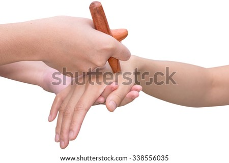 Reflexology hand  massage,Thai spa massage  treatment with wood stick isolate on white with path - stock photo