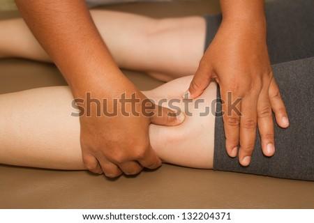 reflexology leg massage ,spa thai massage - stock photo