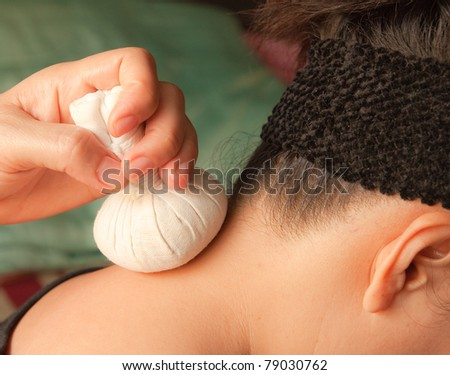 reflexology neck massage, spa the neck treatment by ball-herb,Thailand - stock photo