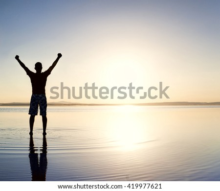 Refreshed man on the beach - stock photo