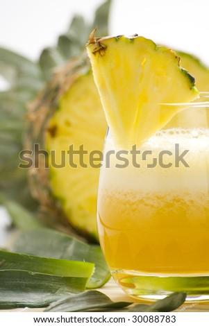 refreshing and creamy pineapple and orange milkshake - stock photo