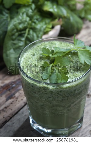 refreshing and detoxifying drink  derived from  plants and vegetables green  leaves selective focus - stock photo