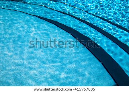 Refreshing aqua swimming pool water and steps underwater - stock photo