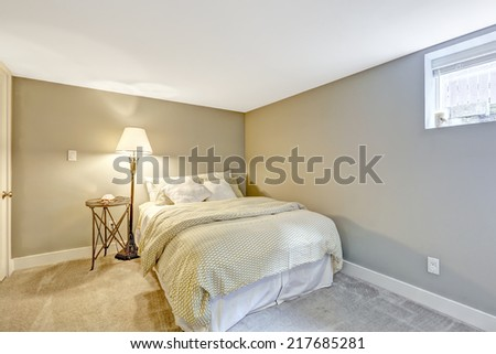 Refreshing bedroom interior with white bed and lamp - stock photo